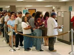 ... Americans waiting in line for government handouts