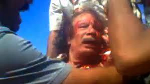 Muammar Gaddhafi beaten before being killed